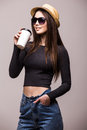 Portrait of happy beauty girl in sunglasses drink tea or coffee from paper cup Royalty Free Stock Photo