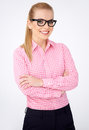 Portrait of a happy blonde geek girl in glasses Royalty Free Stock Image