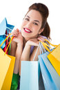 Portrait of a happy brunette holding shopping bags on white background Stock Photo