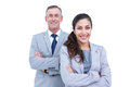 Portrait of happy business people standing together with arms crossed against white background Royalty Free Stock Photo