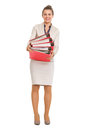 Portrait of happy business woman holding stack of folders full length Royalty Free Stock Images