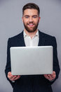 Portrait of a happy businessman holding laptop Royalty Free Stock Photo