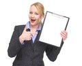 Portrait of a happy businesswoman pointing to blank sign clipboard isolated on white Royalty Free Stock Photo