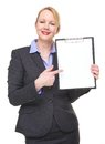 Portrait of a happy businesswoman pointing to empty sign clipboard isolated on white Royalty Free Stock Photography