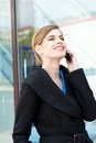 Portrait of a happy businesswoman talking on cellphone close up Stock Photography