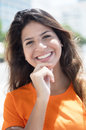Portrait of a happy caucasian woman in a orange shirt in the cit Royalty Free Stock Photo