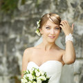 Portrait of happy cheerful smiling bride outdoors young beautiful against break wall Stock Image