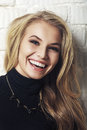 Portrait of happy cheerful smiling young beautiful blond woman