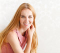 Portrait of happy cheerful smiling young beautiful blond woman indoors Stock Images