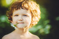 Portrait of happy child holding a daisy in his mouth. Instagram Royalty Free Stock Photo