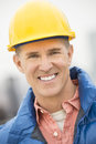 Portrait of happy construction worker close up at site Royalty Free Stock Image