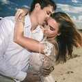 Portrait of happy couple at beach. Traveling at Bali Royalty Free Stock Photo