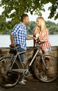 Portrait of happy couple with bicycle outdoor smiling casual handsome men and attractive woman full length Stock Photography
