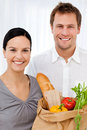 Portrait of a happy couple at home after shopping Stock Photos