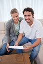 Portrait of a happy couple reading a letter Royalty Free Stock Photo