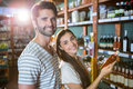 Portrait of happy couple shopping for groceries Royalty Free Stock Photo
