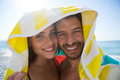 Portrait of happy couple under towel on sunny day Royalty Free Stock Photo