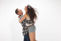 Happy young couple in casual clothes jumping Royalty Free Stock Photo