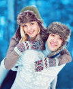 Portrait happy cozy young couple having fun outdoors in winter Royalty Free Stock Photo