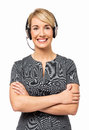 Portrait of happy customer service representative wearing headset isolated over white background vertical shot Stock Photography