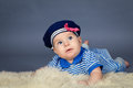 Portrait of happy cute baby girl in sailor dress Royalty Free Stock Photo