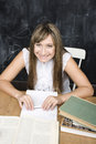 Portrait of happy cute student in classroom at blackboard Royalty Free Stock Photography