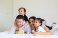 Portrait of a happy family with children in the bedroom Royalty Free Stock Photo