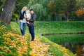 Portrait of happy family with daughter in autumn park Royalty Free Stock Photo