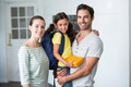 Portrait of happy family with daughter holding lunch box Royalty Free Stock Photo