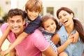 Portrait Of Happy Family In Ga...