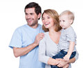 Portrait of the happy family with little child looking sideways isolated on white background Royalty Free Stock Photo