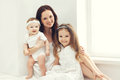 Portrait of happy family, mother together with two children Royalty Free Stock Photo