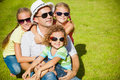 Portrait a happy family sitting on the grass Royalty Free Stock Photo