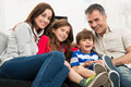 Portrait of happy family a smiling sitting on couch Royalty Free Stock Photo