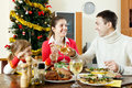 Portrait of Happy family of three celebrating Christmas Royalty Free Stock Photo