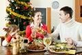 Portrait of Happy family of three celebrating Christmas Royalty Free Stock Photo