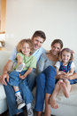 Portrait of a happy family watching TV together Stock Photo