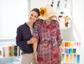 Portrait of happy fashion designer with mannequin Royalty Free Stock Photo