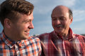 Portrait of happy father and son walking outdoors. Royalty Free Stock Photo