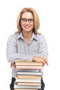Portrait of happy female advocate leaning on books teacher at table with white background Stock Image