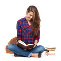 Portrait of happy female student reading a book isolated on white Royalty Free Stock Photo