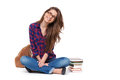 Portrait of happy female student sitting isolated. Royalty Free Stock Photo