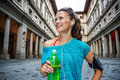 Portrait of happy fitness woman with bottle of water. Florence Royalty Free Stock Photo