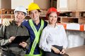 Portrait of happy foreman with supervisors young smiling together at warehouse Stock Photography
