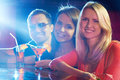 Portrait of happy friends having party in bar Stock Images
