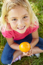 Portrait of happy girl with orange Royalty Free Stock Images