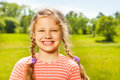 Portrait of happy girl with two braids in summer smiling time Stock Photography