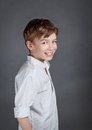 Portrait of happy joy boy on agray background gray indoors studio Stock Photography