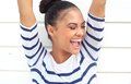 Portrait of a happy latin american smiling with arms raised close up woman Royalty Free Stock Images