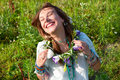 Portrait happy laughs women young woman with flowers Royalty Free Stock Photo